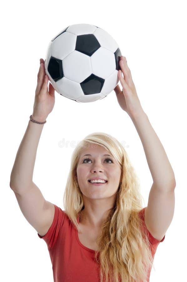 Hållande fotbollboll för kvinna arkivbilder