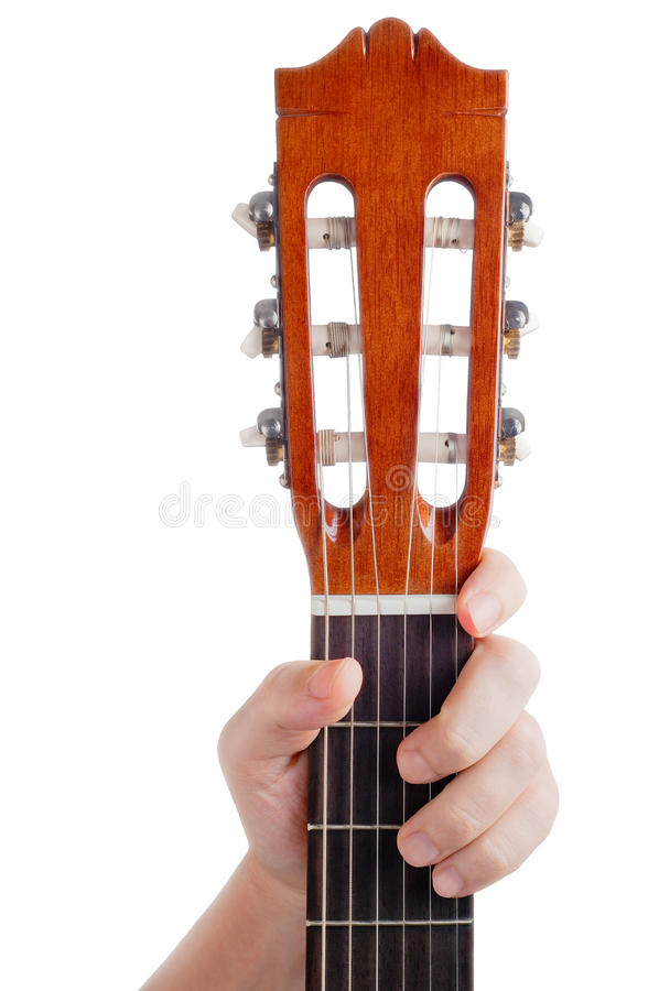 Hållande gitarrhals för manlig hand som isoleras på vit bakgrund med stället för text royaltyfria foton