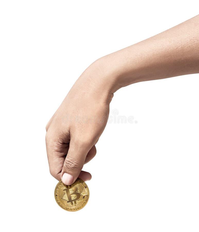 Hållande guld- bitcoin för mänsklig hand royaltyfri foto