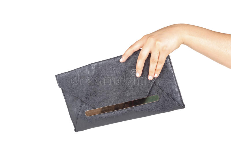 Hållande handväska för kvinnahand arkivfoton