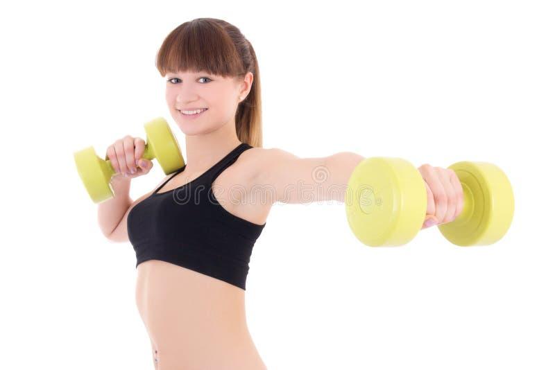 Hållande hantlar för ung sportig kvinna som isoleras på vit arkivfoton