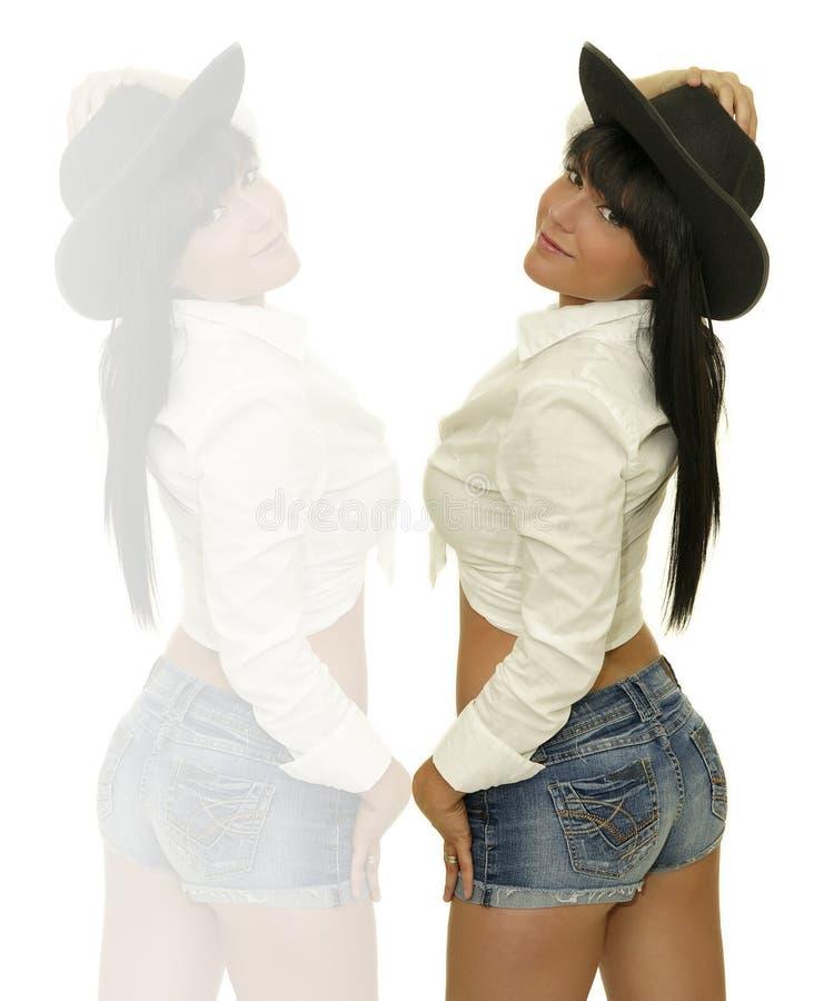 Hållande hatt för cowgirl royaltyfria bilder