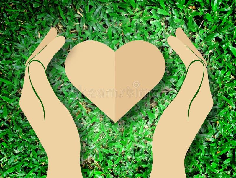 Hållande hjärtaförälskelse för hand bakgrunden för natursymbolgräs royaltyfri illustrationer