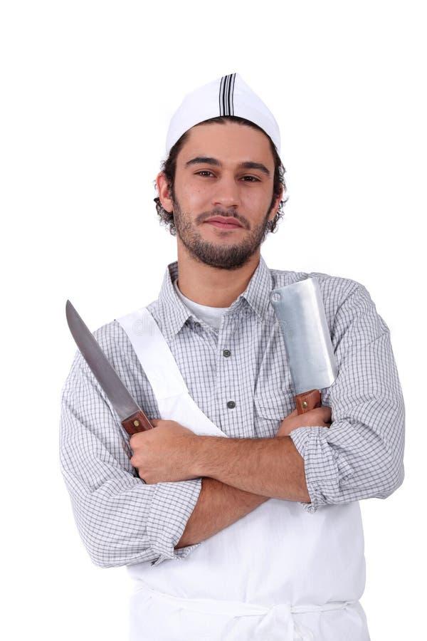 Hållande köttköttyxa för manlig kock royaltyfri fotografi