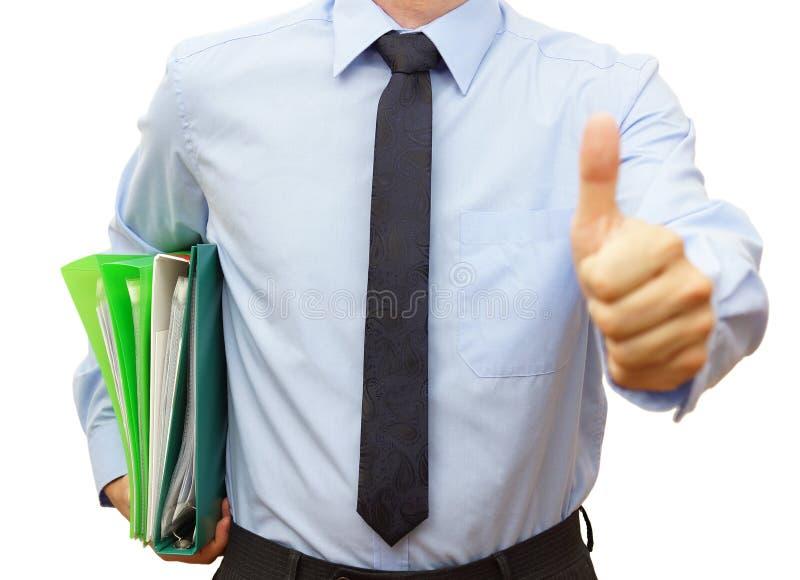 Hållande limbindning för affärsman med dokument och att ge tumme upp mig royaltyfria bilder