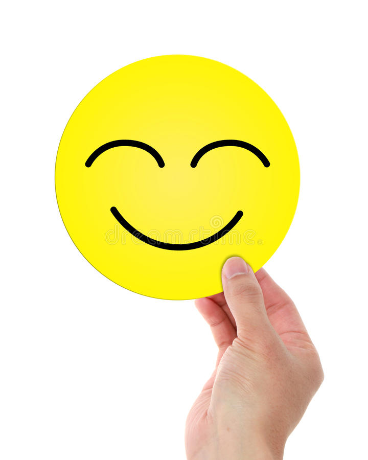 Hållande lyckliga Smiley Face arkivfoton