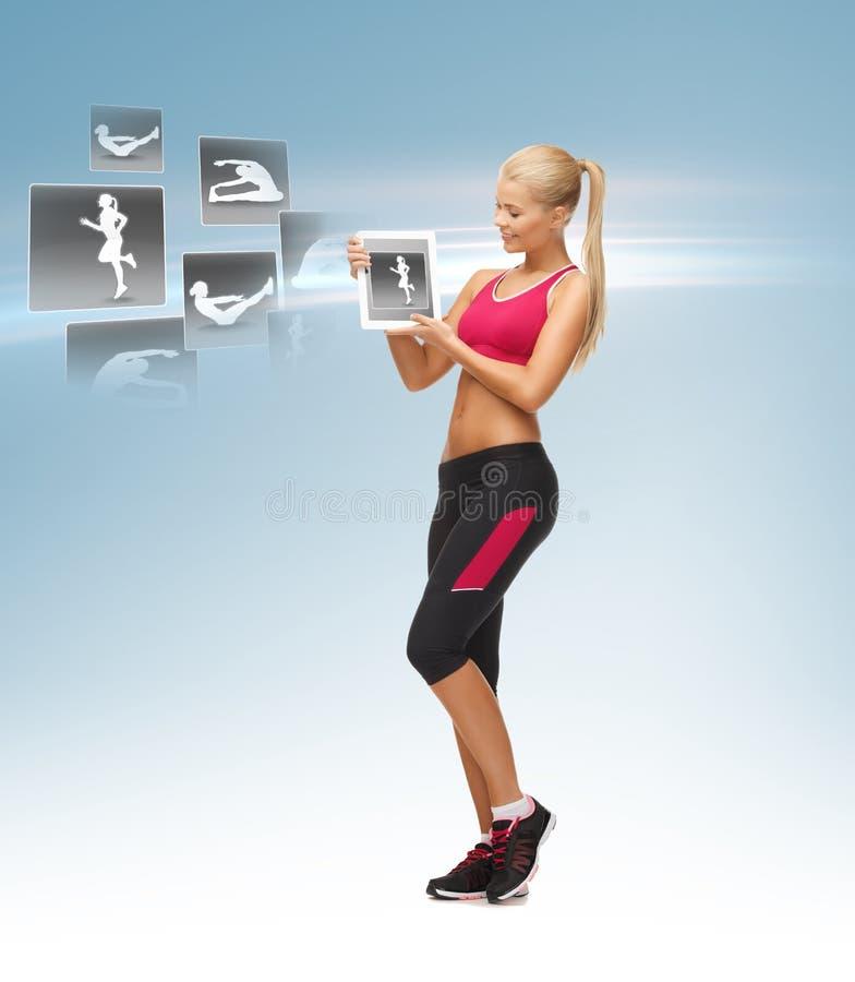 Hållande minnestavlaPC för kvinna med sportapplikation arkivfoto