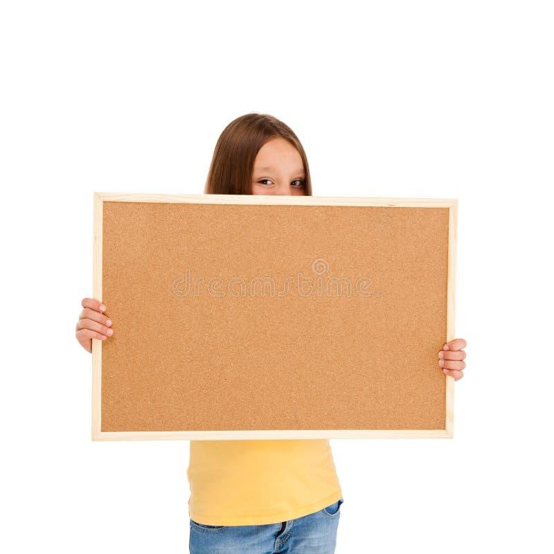 Hållande noticeboard för flicka royaltyfri fotografi