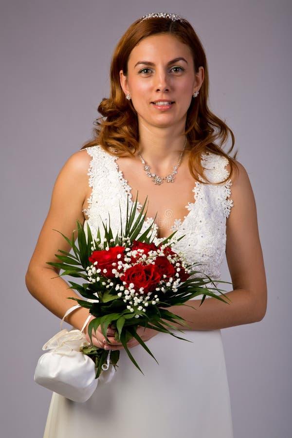 Brud i klänning arkivfoto