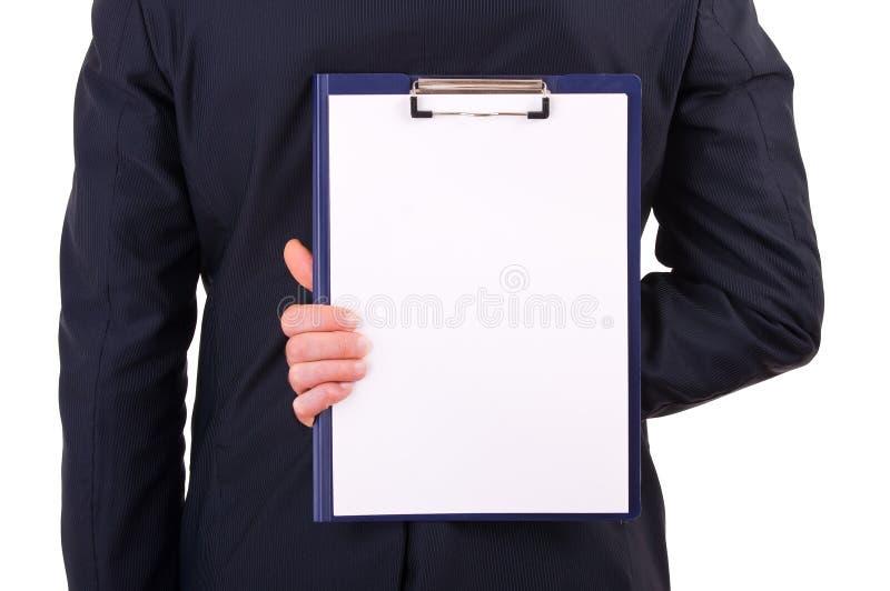 Hållande skrivplatta för affärsman bak baksida arkivfoton
