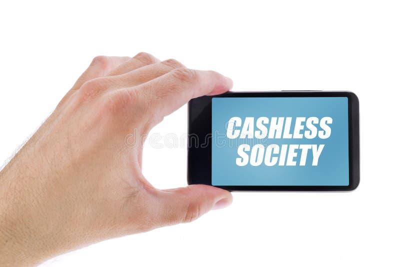 Hållande smartphone för affärsman med Cashless samhälletitel arkivbilder