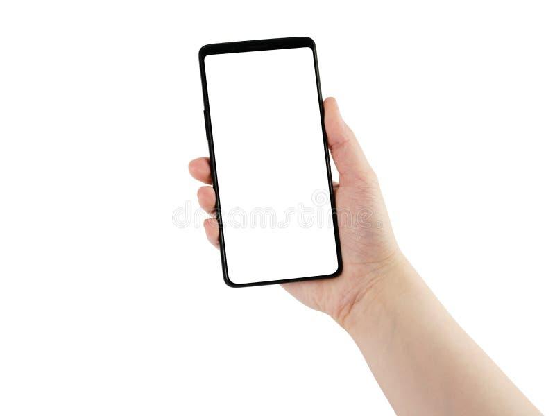 Hållande smartphone för ung kvinnlig hand som isoleras på vit royaltyfria foton