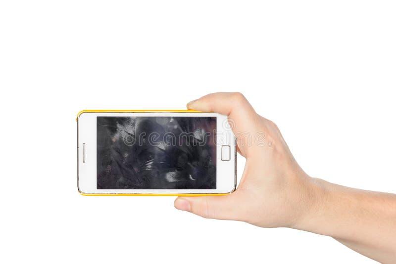 Hållande vit smartphone för hand med fingeravtrycket arkivfoton