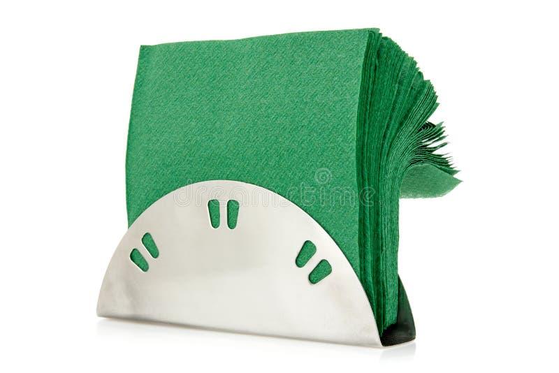 Hållare för tabellservett med gröna servetter royaltyfria bilder