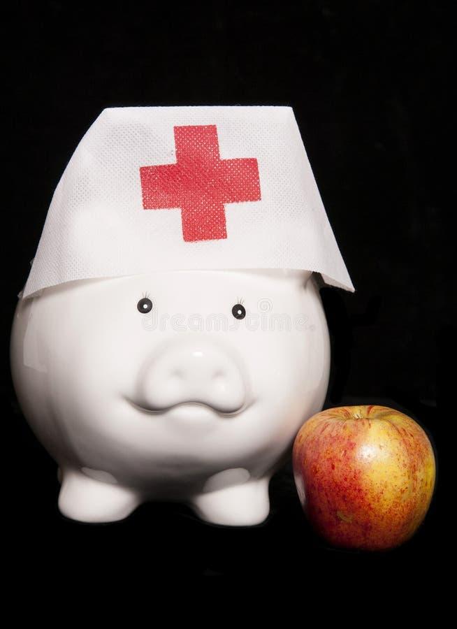 håller den away dagdoktorn för äpplet royaltyfria bilder