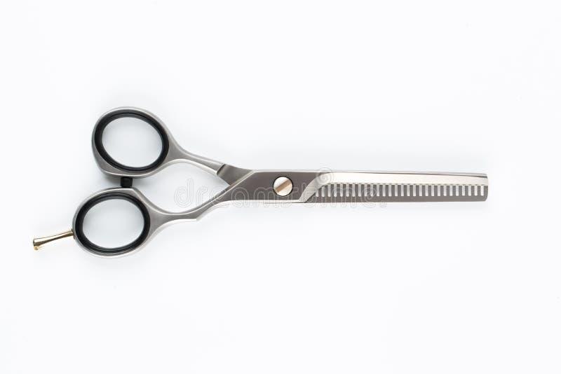 Hår scissor, skäraren och beskäraren på vit backgroun royaltyfri bild