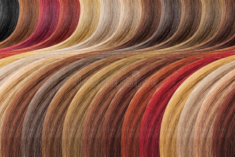 Hårfärgpalett som bakgrund Färgade prövkopior arkivfoton