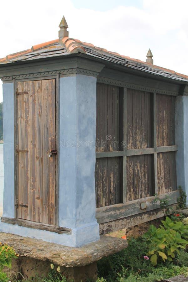 Hórreo azul, O Porto de Bares ( Spain ). The galician granary in O Porto de Bares, Mañón, A Coruña (Galicia). The galician granary is an agricultural stock photography