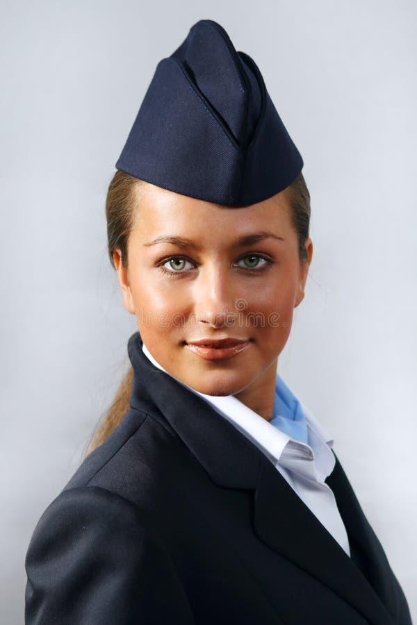 Hôtesse de l'air. Verticale images stock