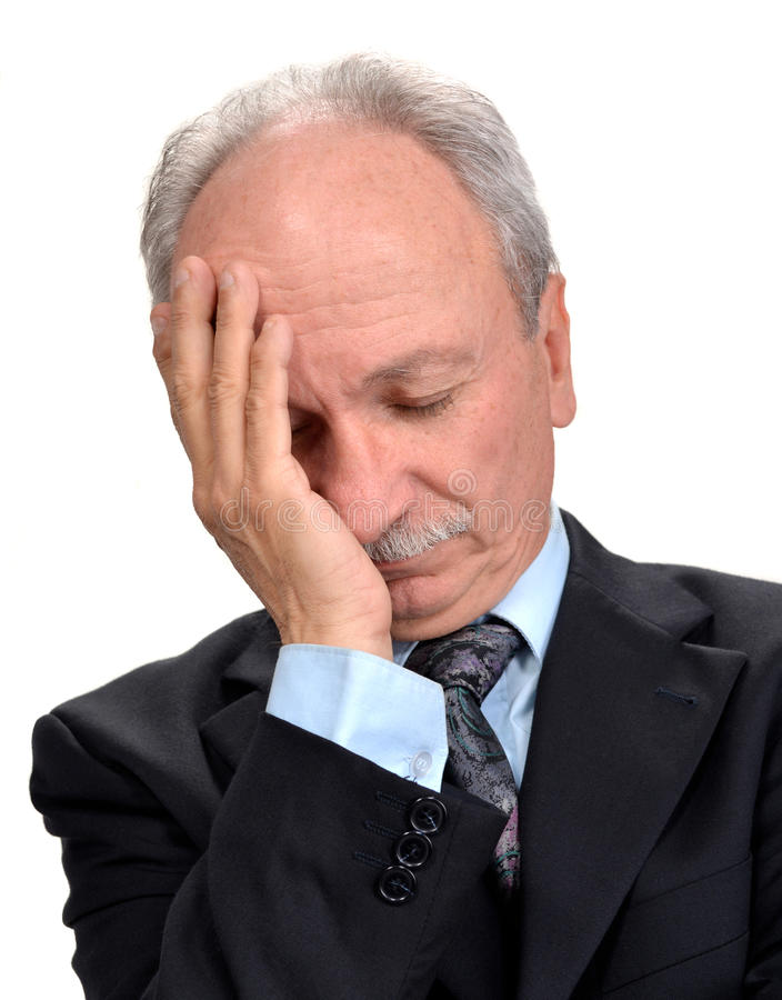 Hög affärsman som har huvudvärk arkivfoto