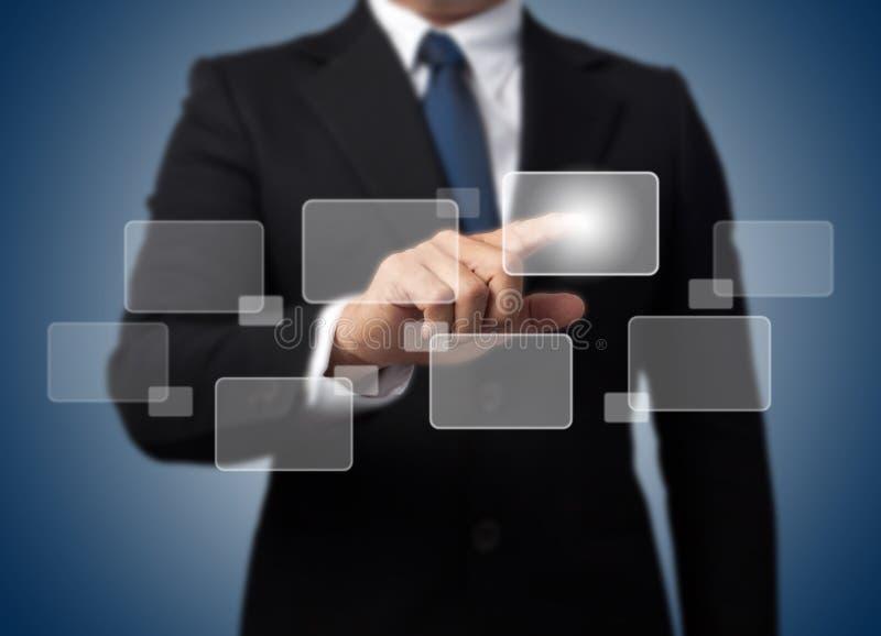 hög affärsman - trycka på för tech arkivbilder