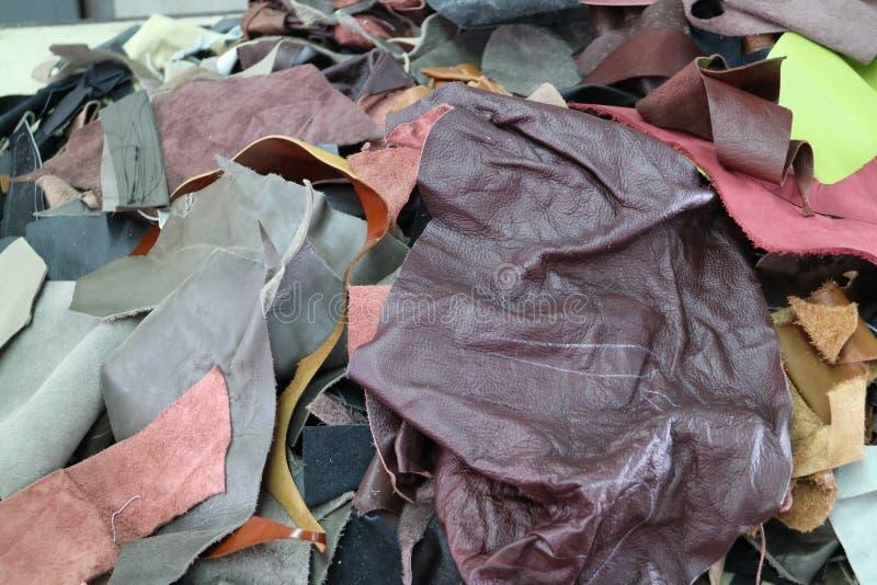 Hög av det lilla stycket av läder arkivfoton