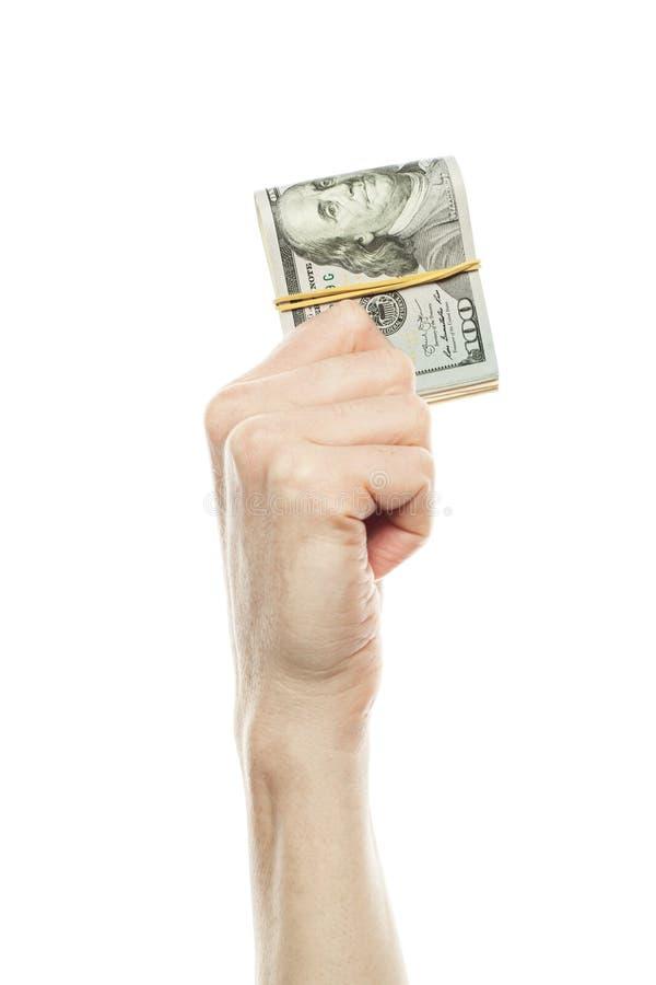 Hög av hundra dollarräkningar som isoleras på en vit bakgrund royaltyfri bild