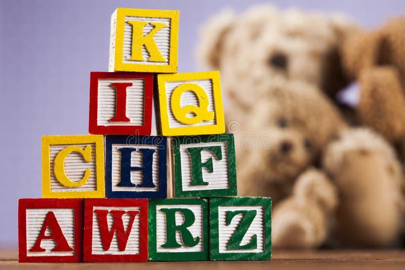 Hög av leksaker, samling på träbakgrund fotografering för bildbyråer