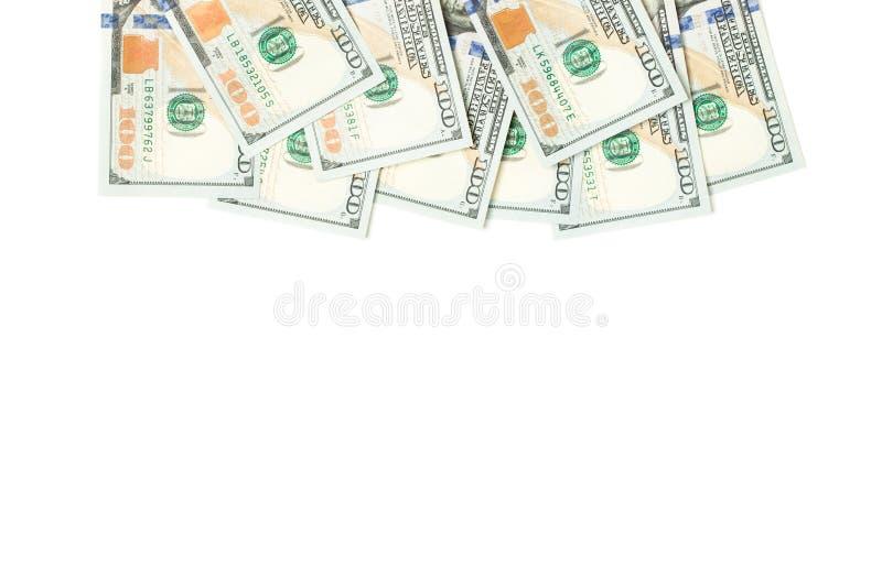 Hög av 100 oss dollargräns som isoleras på vit bakgrund arkivbild