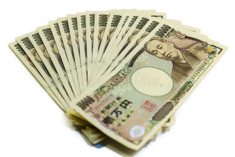 Hög av räkningar för japansk yen som isoleras royaltyfria foton