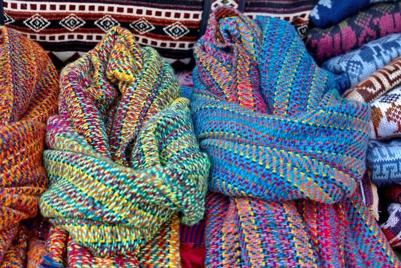 Hög av tröjor och scarves royaltyfria foton