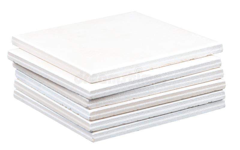 Hög av vita tegelplattor arkivfoto