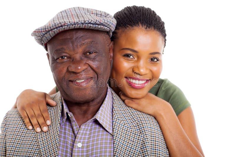 Hög fader för afrikansk dotter  royaltyfria bilder