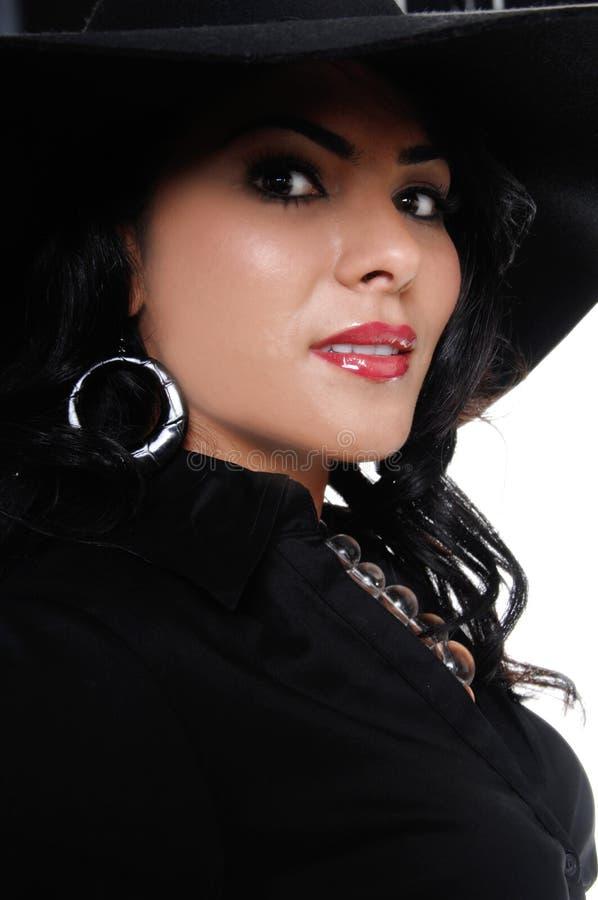 Download Hög kvinna för modehatt arkivfoto. Bild av mode, hatt - 3548122