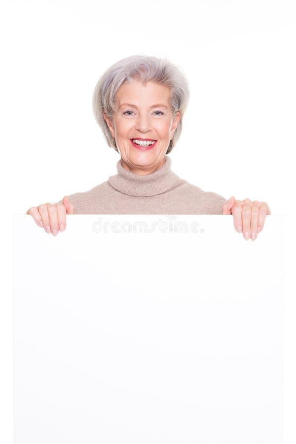 Hög kvinna med det blanka tecknet 库存照片
