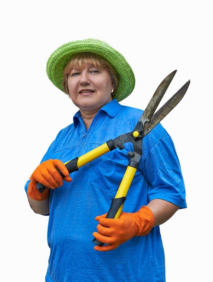 Hög kvinna med trädgårds- sax royaltyfri bild