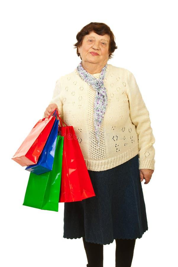 Hög kvinna på shopping royaltyfria foton