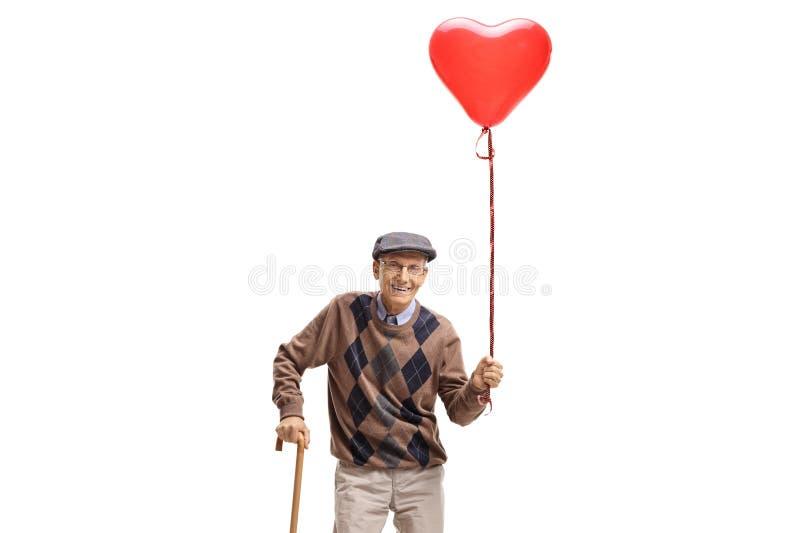 Hög man med en hjärta formad ballong och en rotting royaltyfria bilder