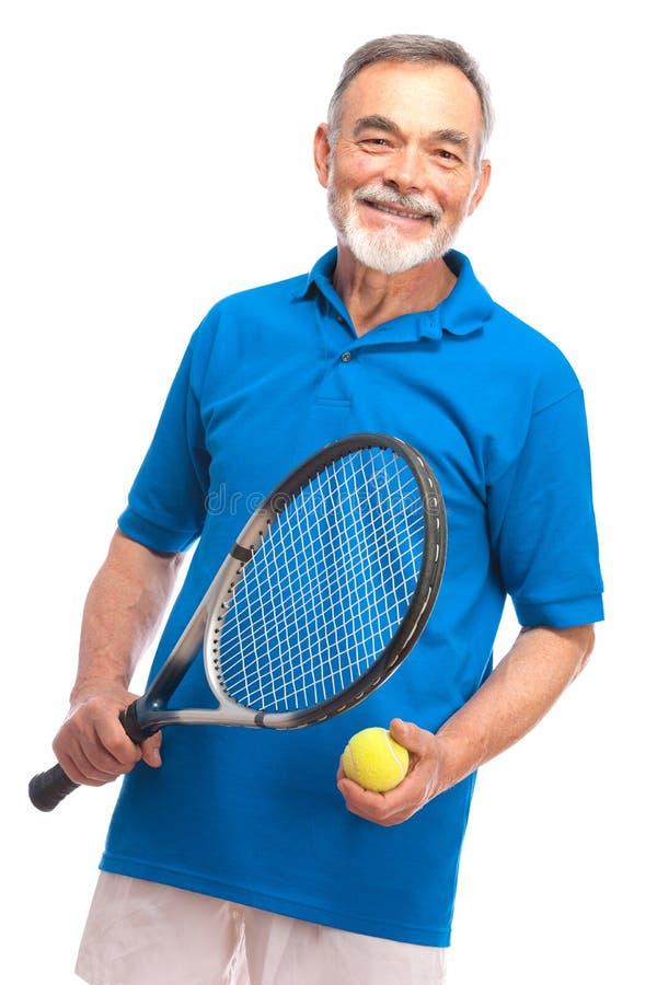 Hög man med ett tennisracket royaltyfria foton