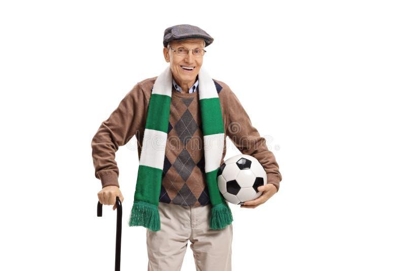 H?g manlig fotbollfan med en halsduk och en fotboll fotografering för bildbyråer