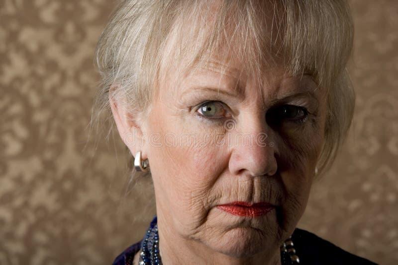 hög skeptical kvinna royaltyfri bild