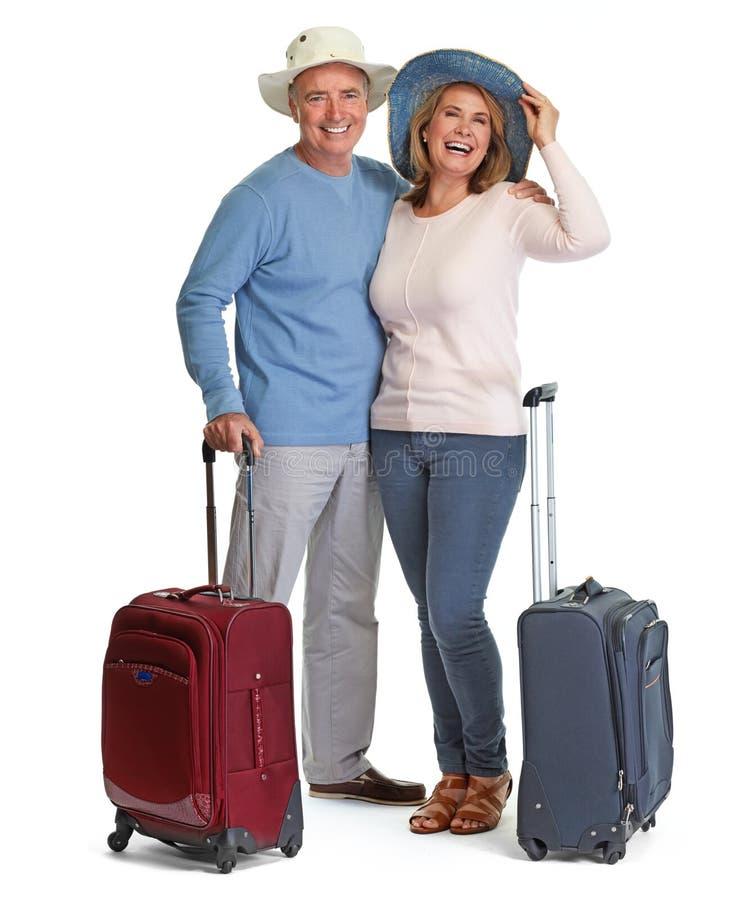 Höga par med bagage arkivbilder