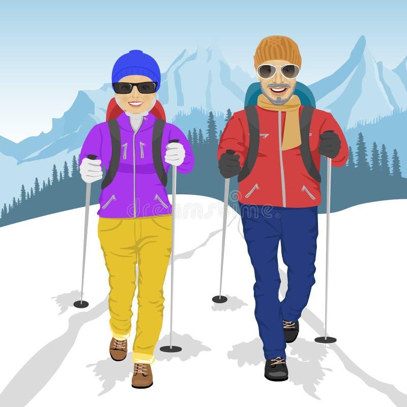 Höga par som bär fotvandra kugghjulet som går i berg i vinter royaltyfri illustrationer