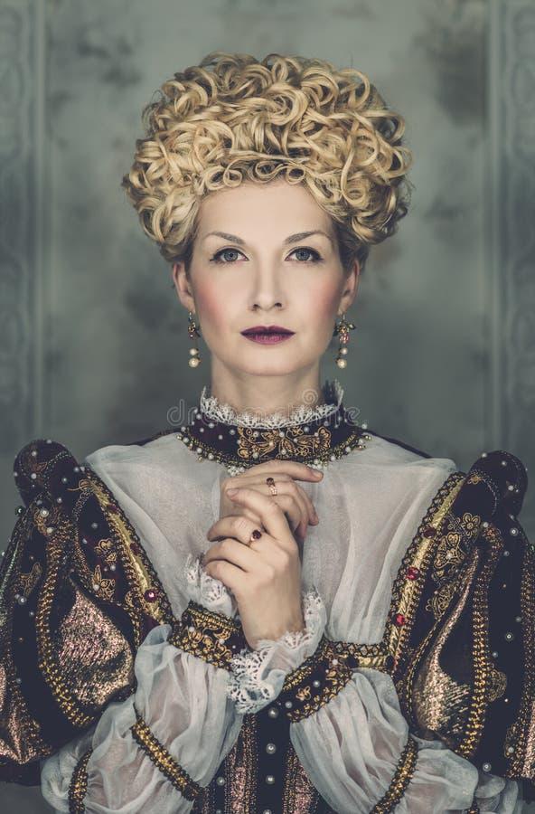 Högdragen drottning royaltyfri bild