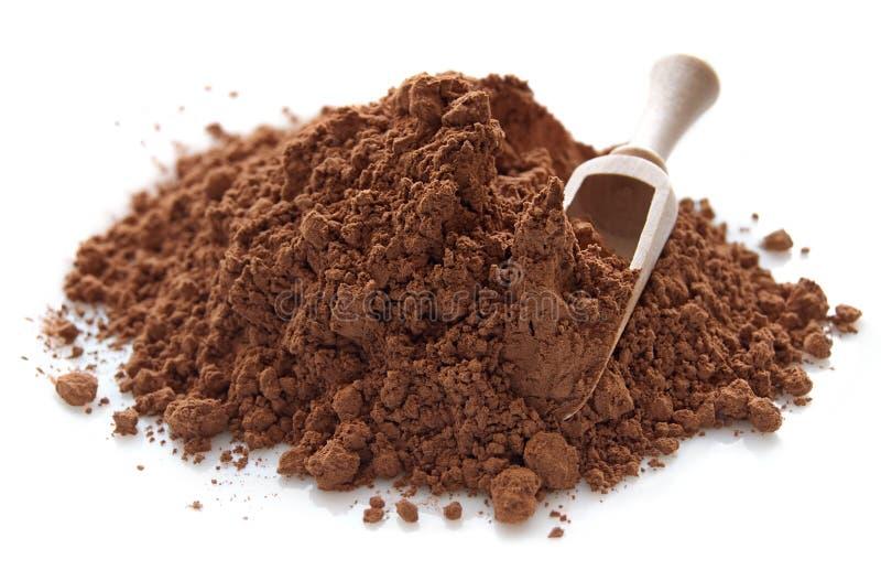 Högen av kakaon pudrar arkivfoton