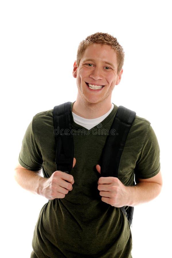 Högskolestudent med den enorma leendeholdingen Bookbag arkivbilder