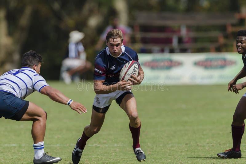Högstadier för lag för rugbyhandling 1st royaltyfri bild