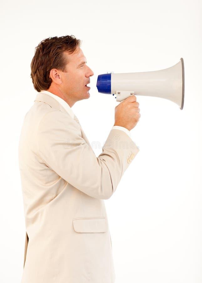 högt tala för affärsmanmegafon royaltyfri fotografi