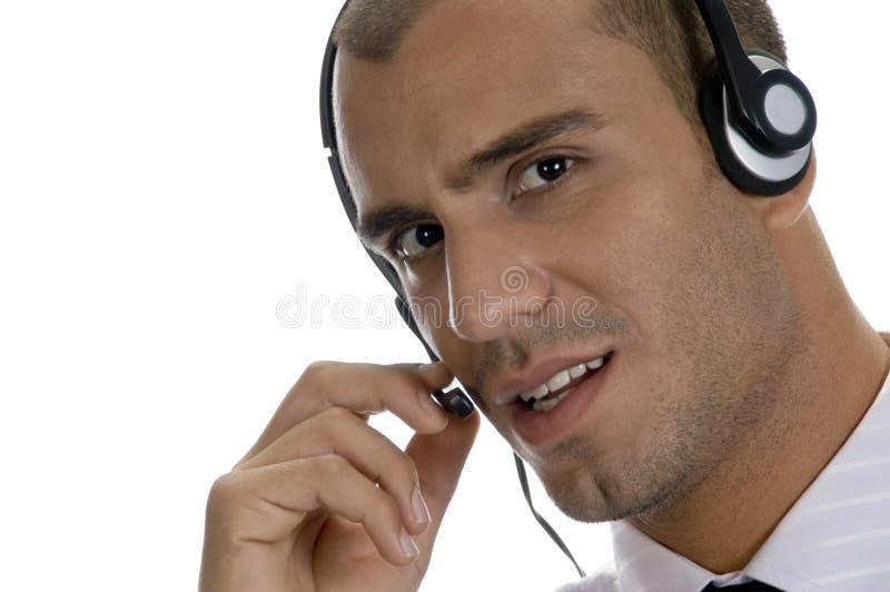 högtalare för affärsmanheadphoneholding royaltyfri foto