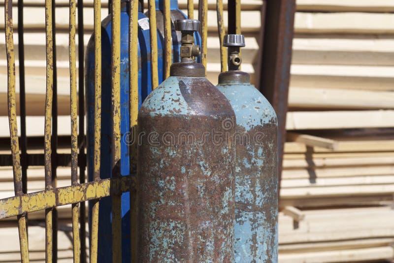 Högtryckcylindrar för komprimerade industriella gaser royaltyfria bilder